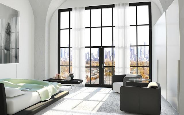 Ett sovrum med utsikt och fantastiska fönster